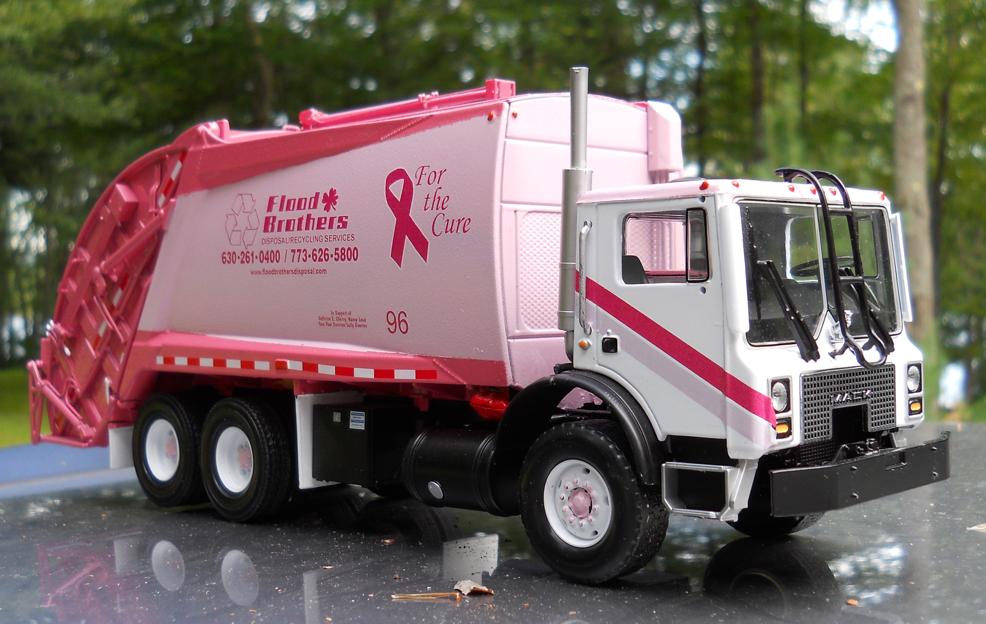 187 flood brothers mcneilus rear packer for breast cancer awareness
